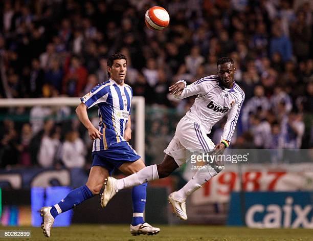 Mahamadou Diarra of Real Madrid fights for the ball with Ivan Rico Soto of Deportivo la Coruna during the La Liga match between Deportivo La Coruna...