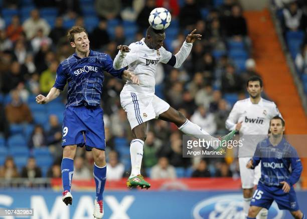 Mahamadou Diarra of Real Madrid jumps for a high ball with Valter Birsa of AJ Auxerre during the Champions League group G match between Real Madrid...