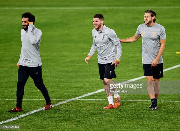 Mahamed Salah of Liverpool FC Alberto Moreno of Liverpool FC and Adam Lallana of Liverpool FC looks on during the training session prior to their...