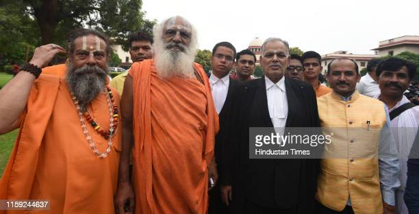 Mahant Dharam Das along with lawyers poses for a photo after the Ayodhya land dispute case hearing at Supreme Court on August 2 2019 in New Delhi...