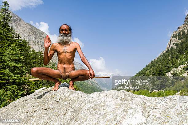 GANGOTRI UTTARAKHAND INDIA Mahant Naomi Giri a 52 years old Sadhu is performing Kriya Yoga at the banks of the holy river Ganges wrapping his penis...