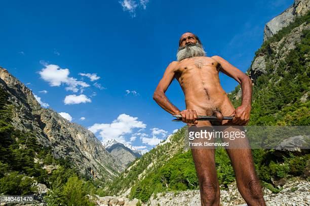 GANGOTRI UTTARAKHAND INDIA Mahant Naomi Giri a 52 years old Sadhu is performing Kriya Yoga at the banks of the holy river Ganges wrapping his penis...