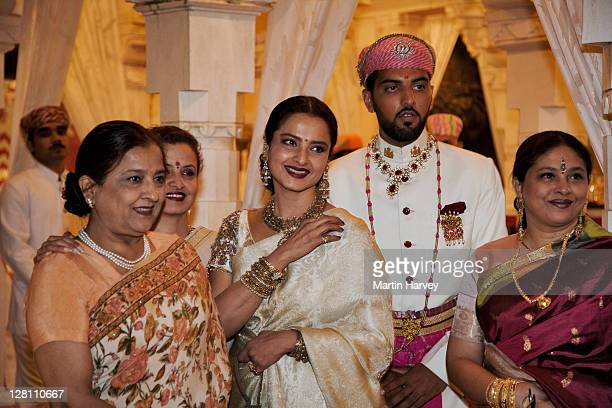 maharaj kumar lakshraj singh with rekha, a well known bollywood actress, and other guests at holi festival. udaipur. india - rekha stock pictures, royalty-free photos & images