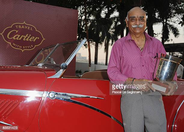 Maharaja Duleep Singhji of Jodhpur poses after receiving an award for the best car of the show Delhaye 135 MS 1935 during the Cartier 'Travel With...