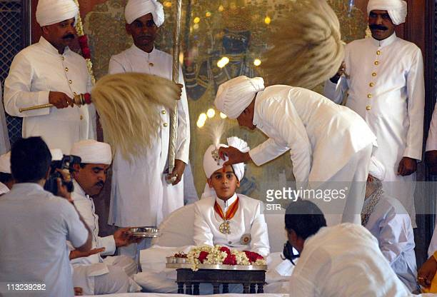 Maharaja of Jaipur Kumar Padmanabh Singh is blessed by priests at his coronation ceremony at the city palace in Jaipur on April 28 2011 Padmanabh...
