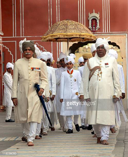 Maharaja of Jaipur Kumar Padmanabh Singh is surrounded by his entourage at his coronation ceremony at the city palace in Jaipur on April 28 2011...