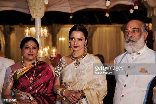 maharana shriji arvind singh mewar with rekha, a well known bollywood actress, and other guests at holi festival. udaipur, india. - rekha stock pictures, royalty-free photos & images