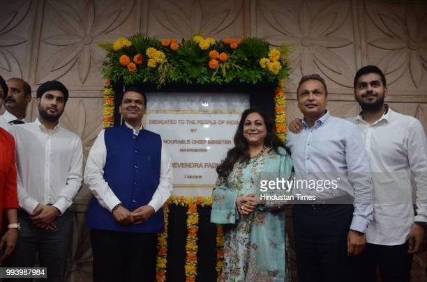 Maharashtra Chief Minister Devendra Fadnavis with Anil Ambani Chairman of Reliance Anil Dhirubhai Ambani Group and his wife Tina Ambani and their...