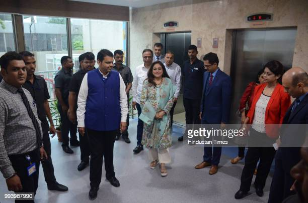 Maharashtra Chief Minister Devendra Fadnavis with Anil Ambani Chairman of Reliance Anil Dhirubhai Ambani Group and his wife Tina Ambani during...