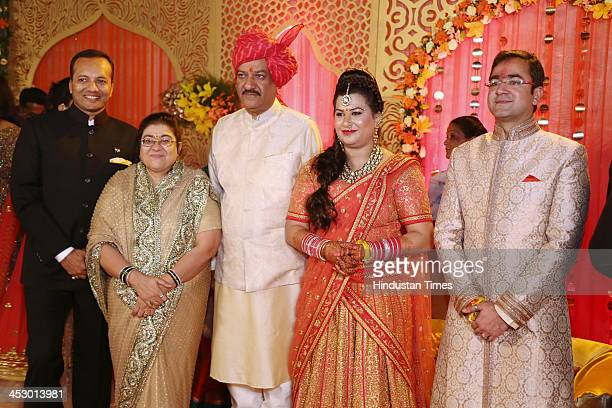 Maharashtra Chief Minister Prithviraj Chavan with wife Satvasheela and daughter Ankita and her groom Prakhar Bhandarey during their wedding ceremony...