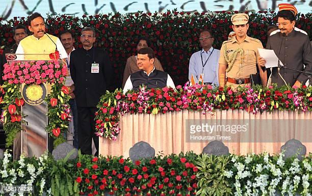 Maharashtra Governor CV Rao administering the oath of office and secrecy to BJP leader Vinod Tawde as Chief Minister of Maharashtra Devendra Fadnavis...