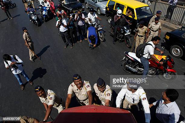 Maharashtra police clearing a blockade created by MNS party workers during a rasta roko at Tilak Bridge Dadar against toll plazas called by MNS chief...