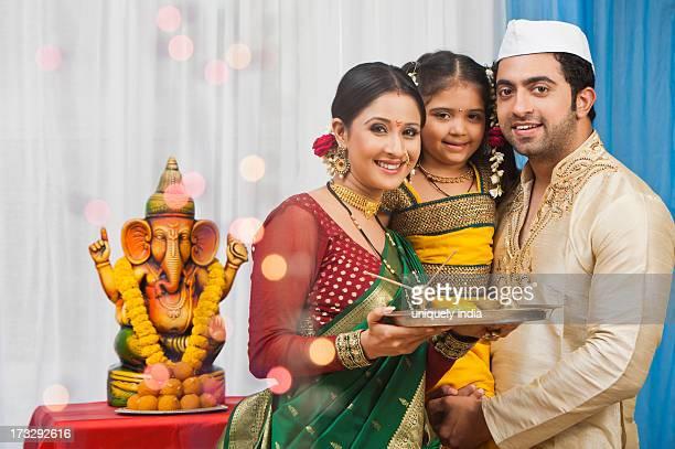 maharashtrian family celebrating ganesh chaturthi - ganesh chaturthi stock photos and pictures