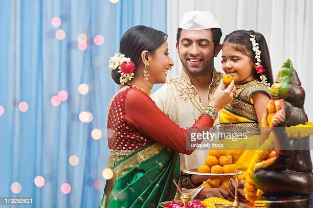 Maharashtrian family celebrating Ganesh Chaturthi
