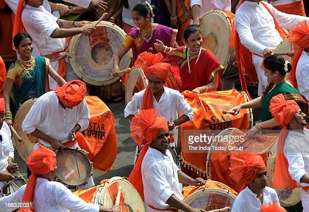 Maharashtrian men and women dressed in traditional attire take part in a procession celebrating 'Gudi Padwa' or the Maharashtrian New Year in Mumbai...