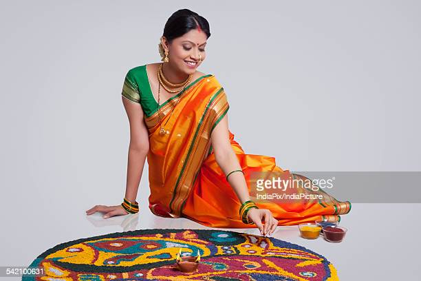 maharashtrian woman making a rangoli - maharashtra stock pictures, royalty-free photos & images