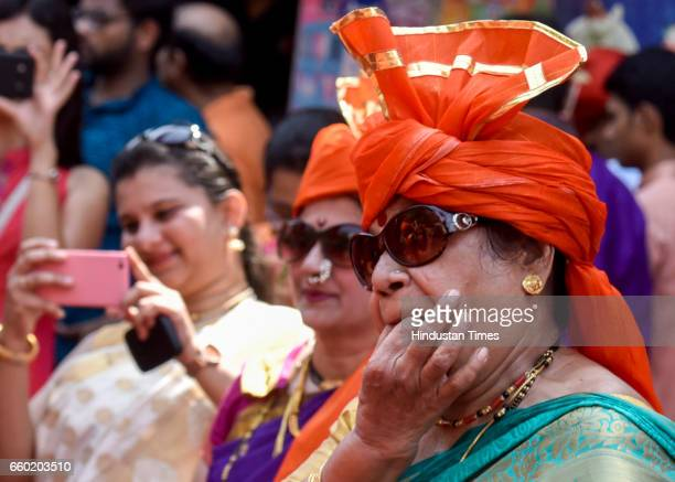 Maharashtrian women dressed in traditional attire as they take part in a procession celebrating 'Gudi Padwa' or the Maharashtrian New Year at Girgaum...