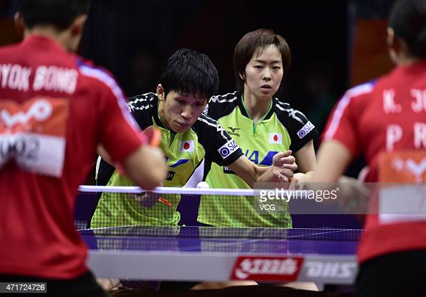 Maharu Yoshimura and Kasumi Ishikawa of Japan compete against Kim Hyok Bong and Kim Jong of North Korea during Mixed Doubles Semifinal Match on day...