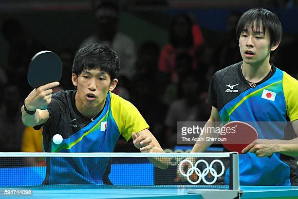 Maharu Yoshimura and Koki Niwa of Japan compete against Zhang Jike and Xu Xin of China during the the Men's Team Table Tennis gold medal match on Day...
