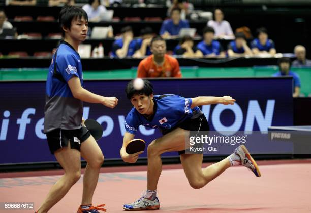Maharu Yoshimura and Koki Niwa of Japan compete in the Men's Doubles final match against Ma Long and Xu Xin of China during day four of the 2017 ITTF...