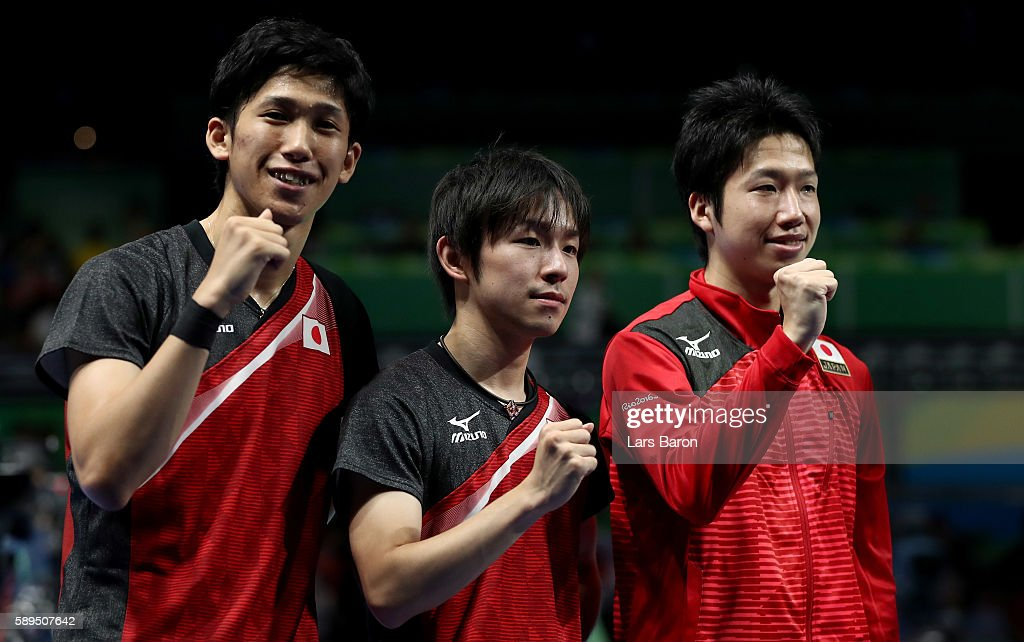 Maharu Yoshimura, Koki Niwa and Jun Mizutani pose for a picture after winning the Table Tennis Men's Quarterfinal Match between Japan and Hong Kong on August 14, 2016 in Rio de Janeiro, Brazil.