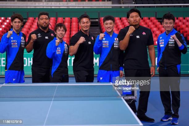 Maharu Yoshimura, Koki Niwa, Tomokazu Harimoto of Japan and Japan Head Coach Yosuke Kurashima pose for photographs with Japan Rugby player Shota...