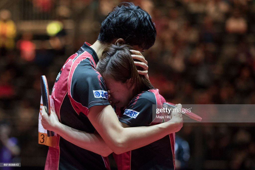 Maharu Yoshimura of Japan and Kasumi Ishikawa (R) hug each other after winning Mixed Doubles Finals at Table Tennis World Championship at Messe Duesseldorf on June 3, 2017 in Dusseldorf, Germany.