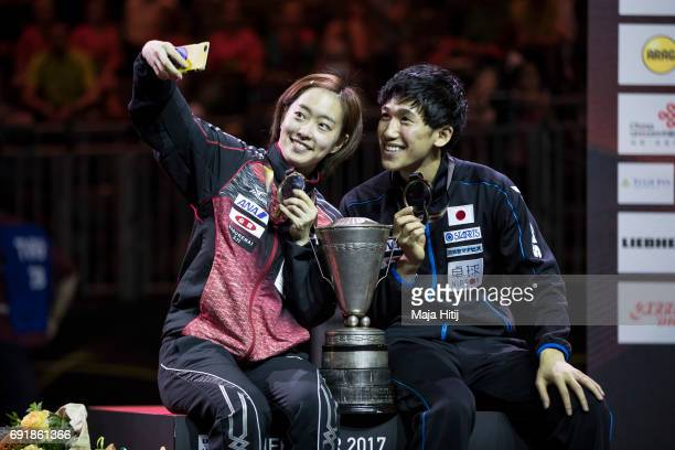 Maharu Yoshimura of Japan and Kasumi Ishikawa make a selfie with a trophy after celebration ceremony after winning Mixed Doubles Finals at Table...