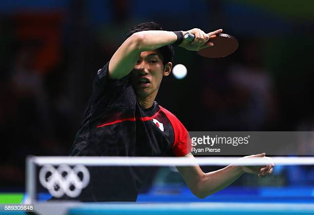 Maharu Yoshimura of Japan plays a forehand during the Table Tennis Men's Team Round One Match between Japan and Poland during Day 8 of the Rio 2016...