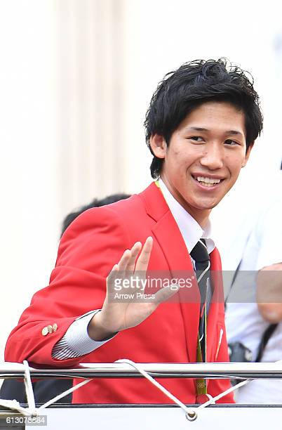 Maharu Yoshimura waves on the top of a double decker bus during the Rio Olympic Paralympic 2016 Japanese medalist parade in the ginza district on...