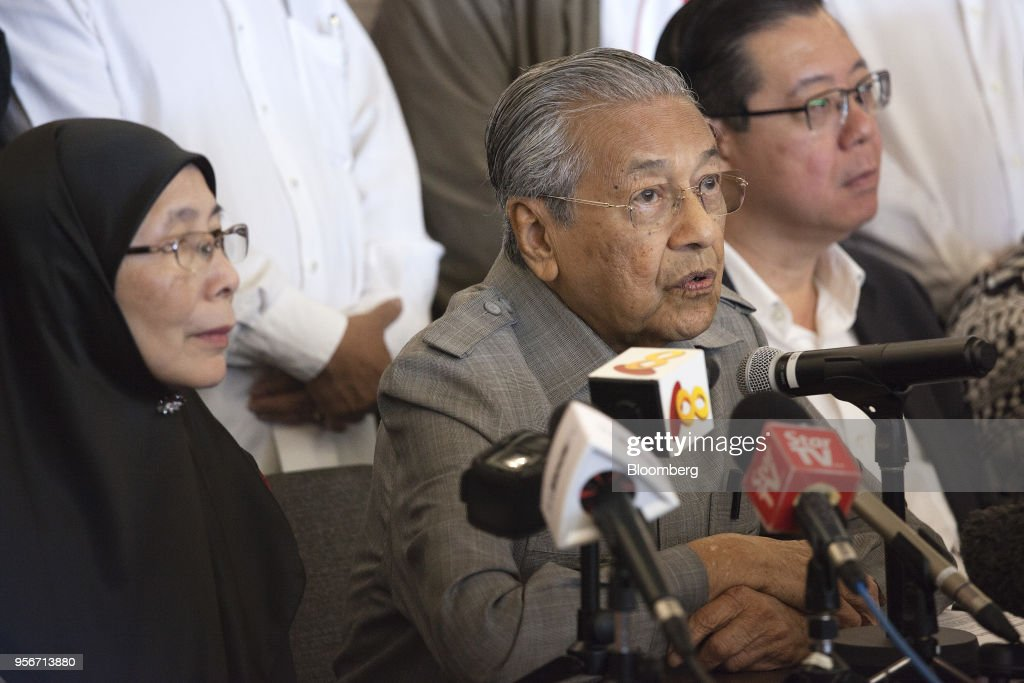 Mahathir Mohamad, Malaysia opposition leader and incoming prime minister, center, speaks as Wan Azizah, president of Parti Keadilan Rakyat (PKR), candidate for deputy prime minister in a Mahathir government and the wife of jailed former opposition leader Anwar Ibrahim, left, listens during a news conference in Kuala Lumpur, Malaysia, on Thursday, May 10, 2018. Mahathir ran Malaysia with an iron fist for more than two decades, played political king maker after leaving power, then came storming out of retirement at the age of 92 to dethrone Prime Minister Najib Razak in a stunning political upset.Photographer: Ore Huiying/Bloomberg via Getty Images