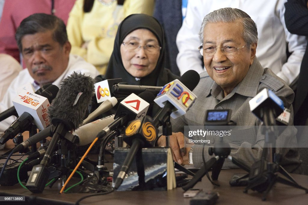 Mahathir Mohamad, Malaysia opposition leader and incoming prime minister, right, speaks as Wan Azizah, president of Parti Keadilan Rakyat (PKR), candidate for deputy prime minister in a Mahathir government and the wife of jailed former opposition leader Anwar Ibrahim, center, listens during a news conference in Kuala Lumpur, Malaysia, on Thursday, May 10, 2018. Mahathir ran Malaysia with an iron fist for more than two decades, played political king maker after leaving power, then came storming out of retirement at the age of 92 to dethrone Prime Minister Najib Razak in a stunning political upset.Photographer: Ore Huiying/Bloomberg via Getty Images