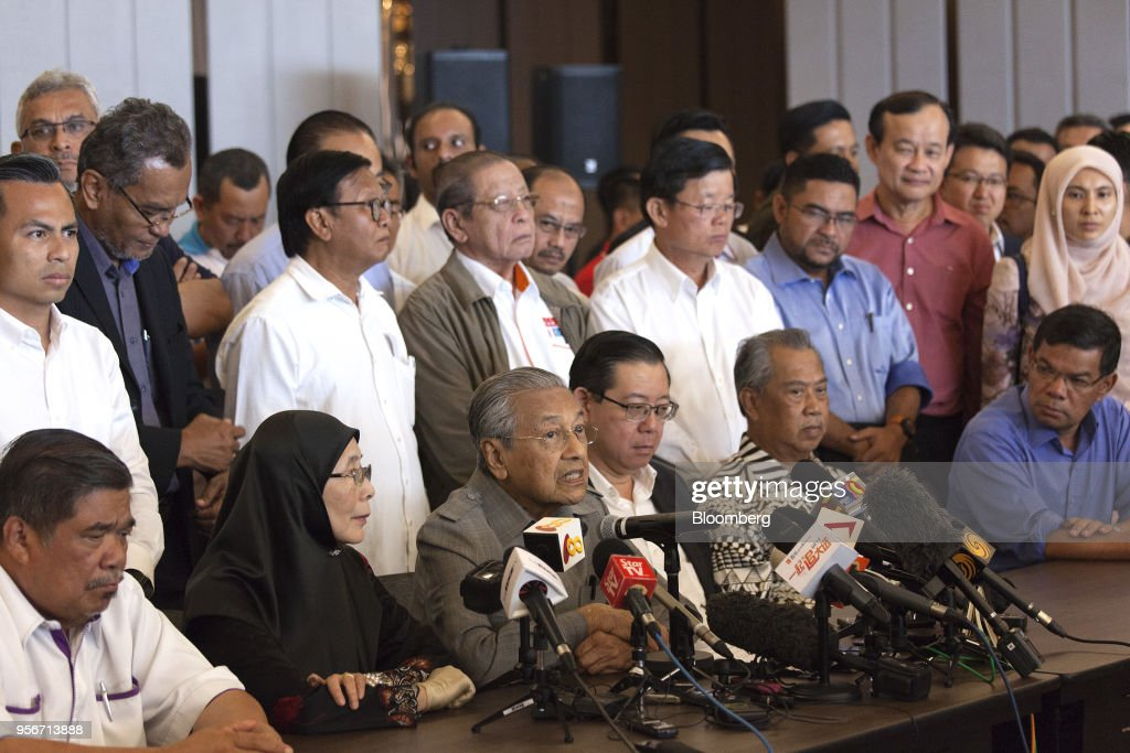 Mahathir Mohamad, Malaysia opposition leader and incoming prime minister, third left, speaks during a news conference in Kuala Lumpur, Malaysia, on Thursday, May 10, 2018. Mahathir ran Malaysia with an iron fist for more than two decades, played political king maker after leaving power, then came storming out of retirement at the age of 92 to dethrone Prime Minister Najib Razak in a stunning political upset.Photographer: Ore Huiying/Bloomberg via Getty Images