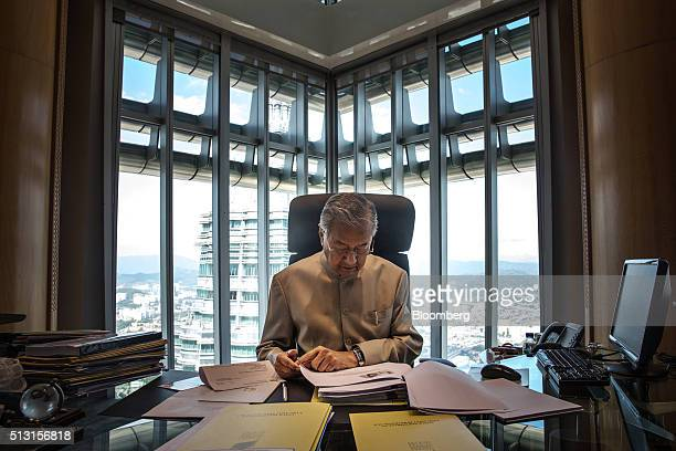 Mahathir Mohamad Malaysia's former prime minister works at his office in Kuala Lumpur Malaysia on Thursday Feb 25 2016 Mahathir Mohamad said he is...