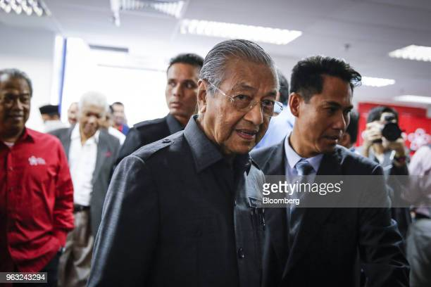 Mahathir Mohamad Malaysia's prime minister center attends a news conference in Petaling Jaya Malaysia on Monday May 28 2018 Mahathir said he will...