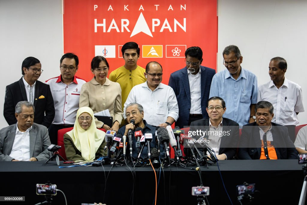 Mahathir Mohamad, Malaysia's prime minister, center, speaks as Muhyiddin Yassin, home affairs minister, seated left, Wan Azizah Wan Ismail, deputy prime minister, seated second left, Lim Guan Eng, finance minister, seated second right, and Mohamad Sabu, defense minister, seated right, listen during a news conference in Selangor, Malaysia, on Thursday, May 17, 2018. Malaysian police seized personal items from former leaderNajib Razaks house in an overnight search, his lawyer said, as Mahathirs week-old government seeks evidence into wrongdoing at state fund 1MDB. Photographer: Sanjit Das/Bloomberg via Getty Images