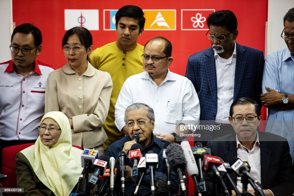 Mahathir Mohamad, Malaysia's prime minister, center, speaks as Wan Azizah binti Wan Ismail, deputy prime minister, seated left, and Lim Guan Eng, finance minister, seated right, listen during a news conference in Selangor, Malaysia, on Thursday, May 17, 2018. Malaysian police seized personal items from former leaderNajib Razaks house in an overnight search, his lawyer said, as Mahathirs week-old government seeks evidence into wrongdoing at state fund 1MDB. Photographer: Sanjit Das/Bloomberg via Getty Images