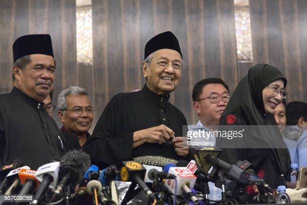 Mahathir Mohamad Malaysia's prime minister smiles during a news conference in Kuala Lumpur Malaysia on Thursday May 10 2018 Mohamadofficially became...