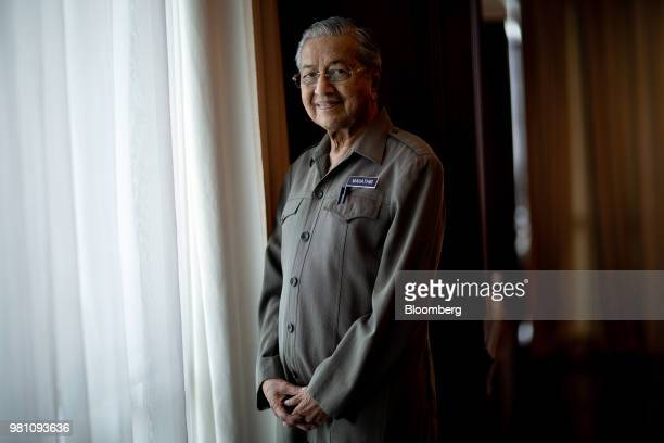 Mahathir Mohamad Malaysias prime minister center offers prayers during the congregational Friday prayer at the National Mosque in Kuala Lumpur...