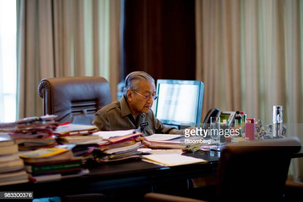 Mahathir Mohamad Malaysias prime minister works in his office in Kuala Lumpur Malaysia on Friday June 22 2018Mahathir said the ringgit's fair value...