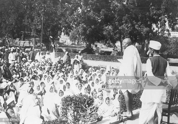 Mahatma Gandhi addressing some of his thousands of followers on the lawn of the home of Dr Ansari where Gandhi stopped during his peace meetings with...