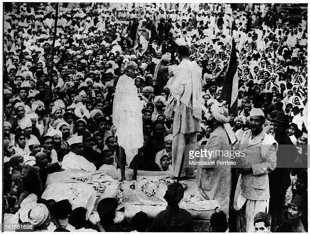 Mahatma Gandhi speaking to the crowd on a makeshift stage druing a rally Peshawar July 1938