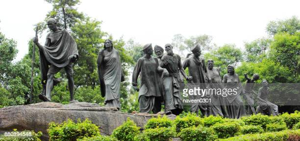 mahatma gandhi statue depicting dandi march in new delhi, india - black civil rights stock pictures, royalty-free photos & images