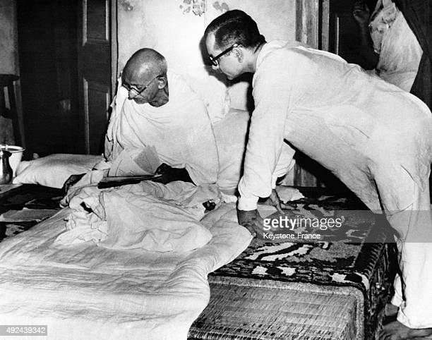 Mahatma Gandhi working on his bed while fasting for peace on September 11 1947 in Kolkata India