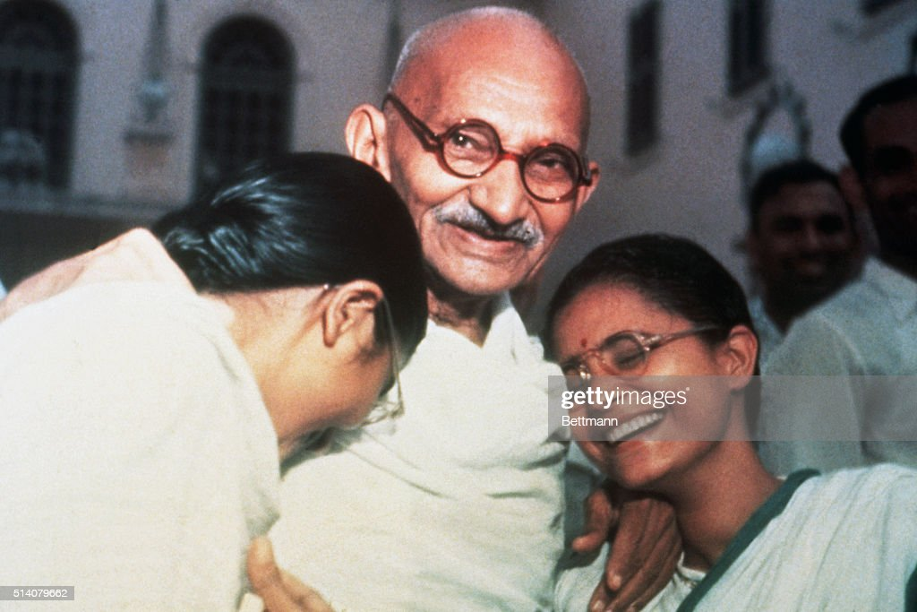 Mahatma Ghandi enjoys a laugh with his two granddaughters Ava and Manu at Birla House in New Delhi.