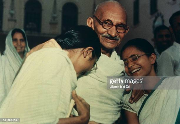 Mahatma Ghandi Indian politician with his granddaughter Manu and his grandnephew Kanuïs wife Abha in Birla House in Delhi around January 1948