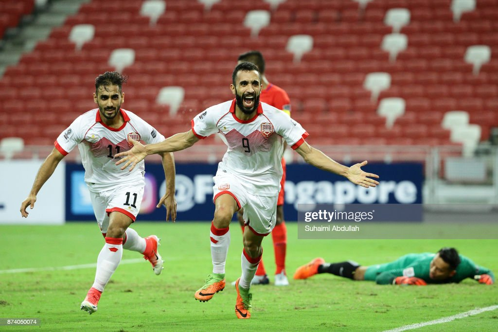 Mahdi Abdul Jabbar of Bahrain (front) reacts after scoring the first goal during the 2019 Asian Cup Qualifier match between Singapore and Bahrain at National Stadium on November 14, 2017 in Singapore.