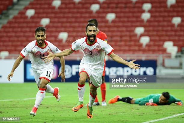 Mahdi Abdul Jabbar of Bahrain reacts after scoring the first goal during the 2019 Asian Cup Qualifier match between Singapore and Bahrain at National...