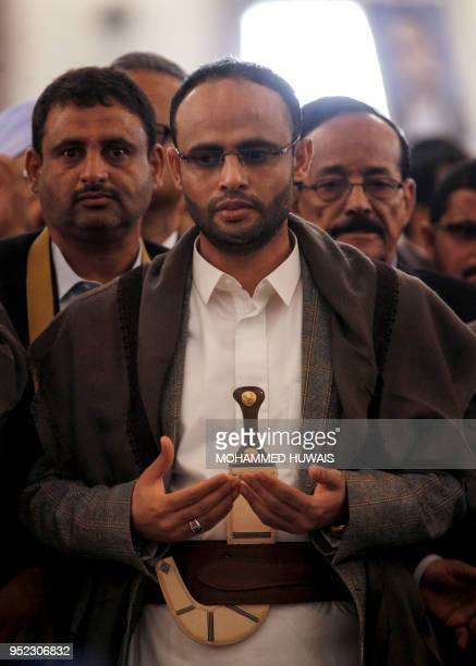Mahdi alMashat who was appointed to succeed Saleh alSamad as head of the Huthi Supreme Political Council prays during the funeral of alSamad and his...