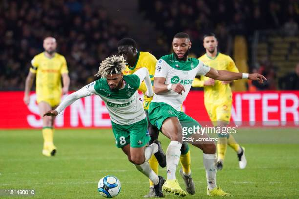 Mahdi CAMARA of Saint Etienne and Harold MOUKOUDI of Saint Etienne during the Ligue 1 match between Nantes and Saint Etienne at Stade de la Beaujoire...